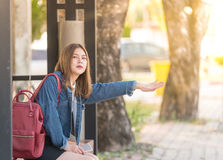 Portrait of a beautiful young Asia woman waiting for a bus or call Something Royalty Free Stock Photo