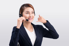 Portrait of beautiful young asian female customer service repres Royalty Free Stock Image