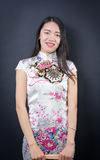 Portrait of a beautiful young asian woman in a dress. Portrait of a beautiful young asian woman in a white dress Royalty Free Stock Images