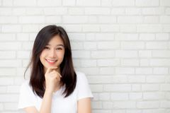 Portrait of beautiful young asian woman happiness standing on gray cement texture grunge wall brick background. Portrait of beautiful young asian woman stock image