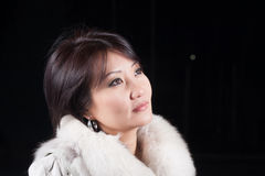 Fashion asian woman. Portrait of a beautiful young Asian woman. she mysteriously looks up and think of something pleasant Royalty Free Stock Image