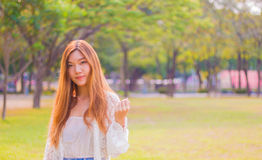 Portrait of a beautiful young Asian woman outdoor Stock Image