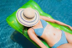 Portrait beautiful young asian woman smile happy relax and leisure in the swimming pool royalty free stock images