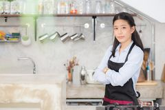 Portrait of beautiful young barista, asian woman is a employee. Standing in counter coffee shop, service concept Royalty Free Stock Photography