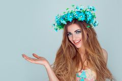 woman with floral headband showing empty copy space royalty free stock photography