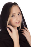 Portrait of a beautiful young blond girl. Portrait of a girl with shawl on her head, isolated on white background Stock Photo