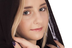 Portrait of a beautiful young blond girl. Portrait of a girl with shawl on her head, isolated on white background Stock Photography