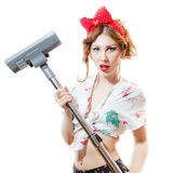 Portrait of beautiful young blond pinup woman holding vacuum cleaner looking in camera isolated on white copy space background Stock Photography