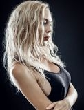 Portrait of beautiful young blond woman on black Stock Image