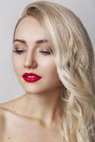 Portrait of beautiful young blond woman with clean face.Red lips.Glamour portrait of beautiful woman model with evening makeup Stock Photos