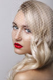 Portrait of beautiful young blond woman with clean face.Red lips.Glamour portrait of beautiful woman model with evening makeup Stock Photography