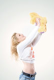 Portrait of beautiful young blond woman in stylish jeans and a soft toy. On isolated white background Stock Images