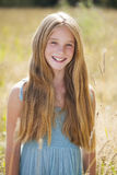 Portrait of a beautiful young blonde little girl. On the background of summer park stock photo