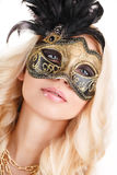 Portrait of Beautiful young blonde woman in black and gold mysterious venetian mask. Fashion photo on white background Stock Images