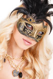 Portrait of Beautiful young blonde woman in black and gold mysterious venetian mask. Fashion photo on white background Royalty Free Stock Images