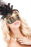 Portrait of Beautiful young blonde woman in black and gold mysterious venetian mask. Fashion photo on white background Royalty Free Stock Photo