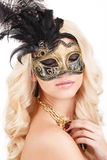 Portrait of Beautiful young blonde woman in black and gold mysterious venetian mask. Fashion photo on white background Royalty Free Stock Photography