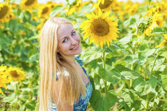 Portrait of a beautiful young blonde woman in blue dress on a ba Royalty Free Stock Photography