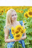 Portrait of a beautiful young blonde woman in blue dress on a ba Stock Image