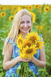 Portrait of a beautiful young blonde woman in blue dress on a ba Royalty Free Stock Photo