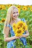 Portrait of a beautiful young blonde woman in blue dress on a ba Stock Images