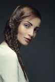 Portrait of beautiful young blonde woman with creative braids ha Royalty Free Stock Photo