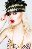 Portrait of beautiful young blonde woman in extravagant hat on white background Royalty Free Stock Image