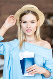 Portrait of beautiful young blonde woman in hat holding passports and tickets. Getting ready to travel concept Royalty Free Stock Photos