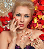 Portrait of Beautiful young blonde woman lying on floor  Royalty Free Stock Photography