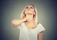 Portrait of a beautiful young woman with painful neck stock photography