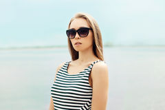 Portrait of beautiful young blonde woman in sunglasses Royalty Free Stock Image