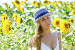 Portrait of a beautiful young blonde woman in a white dress on a Royalty Free Stock Images