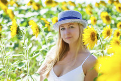 Portrait of a beautiful young blonde woman in a white dress on a Royalty Free Stock Photo