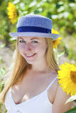 Portrait of a beautiful young blonde woman in a white dress on a Royalty Free Stock Image