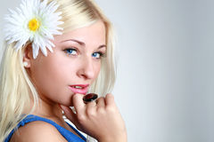 Portrait of a beautiful young blue eyed woman Stock Images