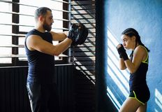 Portrait beautiful young boxing woman training punching in gym stock photos
