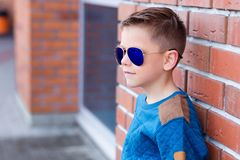 Portrait of a beautiful young boy outdoors Stock Images