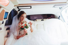 Portrait of a beautiful young bride in the car Royalty Free Stock Images