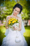 Portrait of beautiful young bride in garden Stock Photo