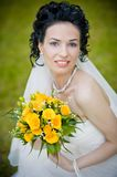Portrait of beautiful young bride in garden Royalty Free Stock Images