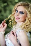 Portrait beautiful young bride in white dress in summer green park Royalty Free Stock Image