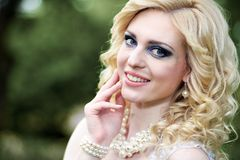Portrait beautiful young bride in white dress in summer green park Royalty Free Stock Photography