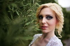 Portrait beautiful young bride in white dress in summer green park Stock Images