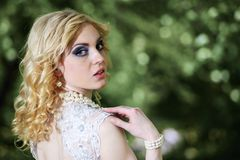 Portrait beautiful young bride in white dress in summer green park Stock Photos
