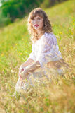 Portrait of a beautiful young brown-haired woman. In nature in a lace dress Stock Images
