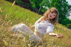Portrait of a beautiful young brown-haired woman. In nature in a lace dress Royalty Free Stock Images