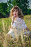 Portrait of a beautiful young brown-haired woman. In nature in a lace dress Royalty Free Stock Photos