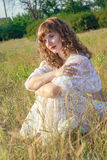 Portrait of a beautiful young brown-haired woman. In nature in a lace dress Stock Photo