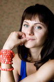 Portrait of a beautiful young brunette with beads Stock Image