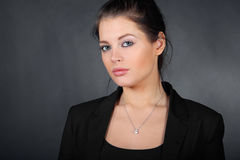 Portrait of beautiful young brunette girl Stock Photos